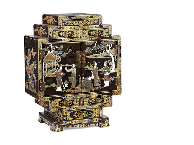 A Chinese export early 20th century hardstone and etched ivory mounted tabletop cabinet