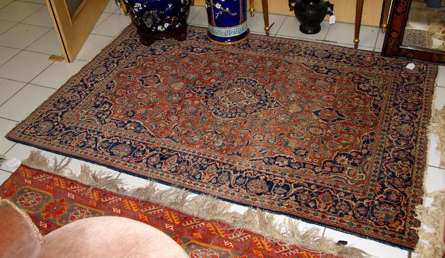 A Kashan rug, 135 x 195cm