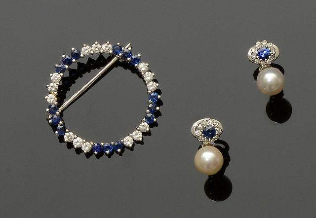 A sapphire and diamond circlet brooch and a pair of vari gem-set earclips (2)