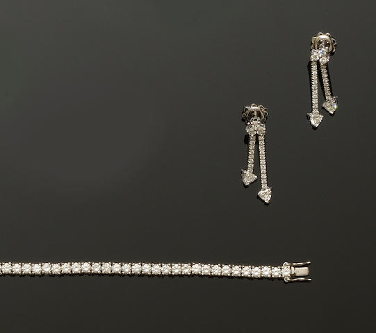 A diamond line bracelet and a pair of diamond earpendants (2)