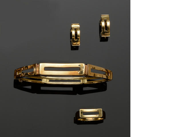 Mappin & Webb: An 18ct gold ring, bangle and earhoops suite (3)