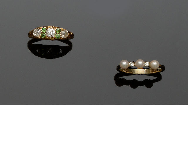 An early 20th century diamond and demantoid garnet ring and a cultured pearl and diamond ring  (2)