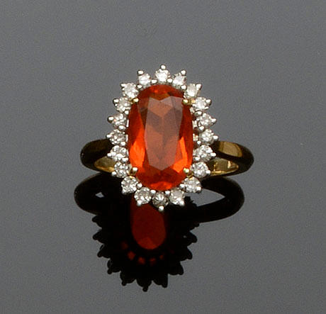 An 18ct gold fire opal and diamond cluster ring