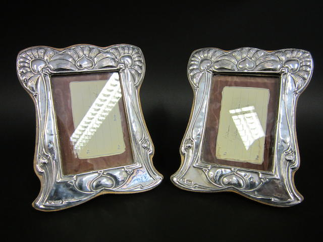 An Art Nouveau silver pair of photograph frames by WJ Myatt & Co, Birmingham 1906