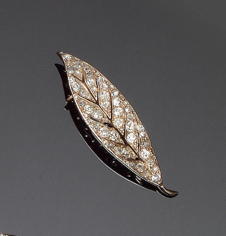 A diamond leaf brooch