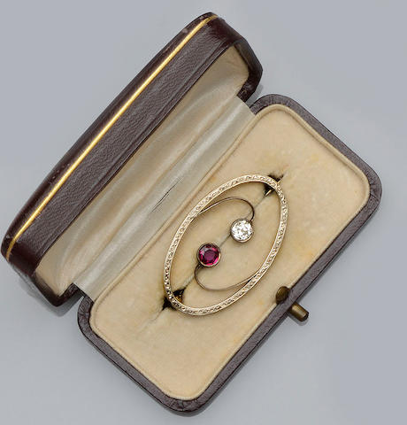 A synthetic ruby and diamond oval brooch