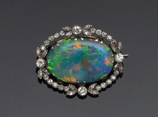 An opal doublet and diamond panel brooch
