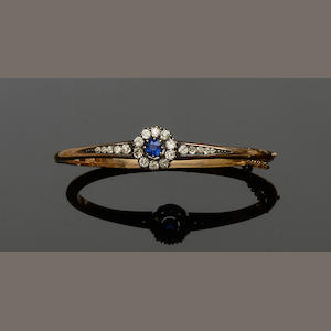 A late Victorian sapphire and diamond hinged bangle