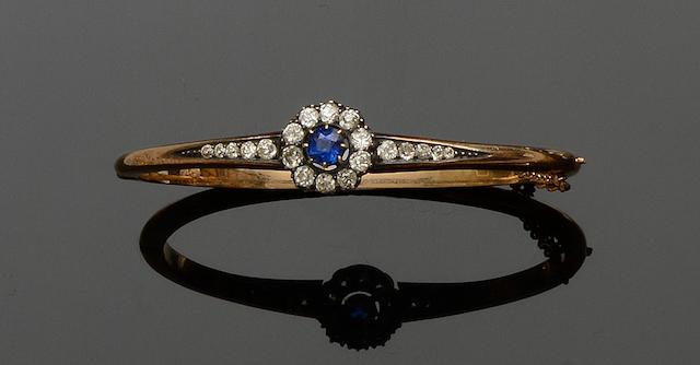 A late Victorian sapphire and diamond hinged bangle