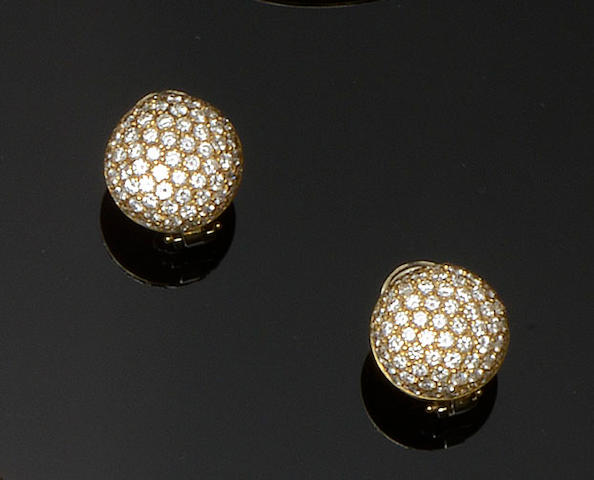 A pair of diamond bombé earclips
