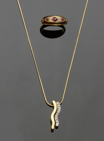 A diamond pendant necklace and a ruby and diamond ring (2)