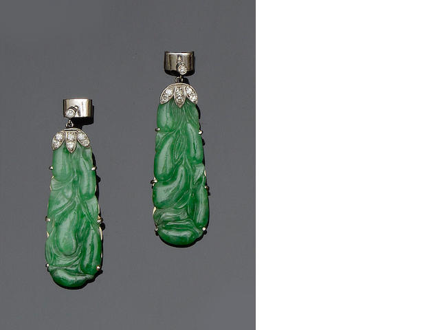 A pair of carved jadeite and diamond earpendants