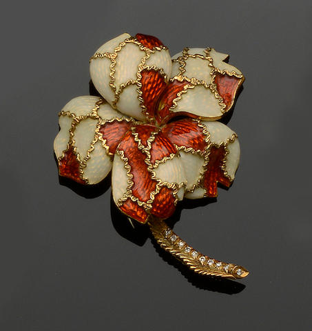 An enamelled flower brooch