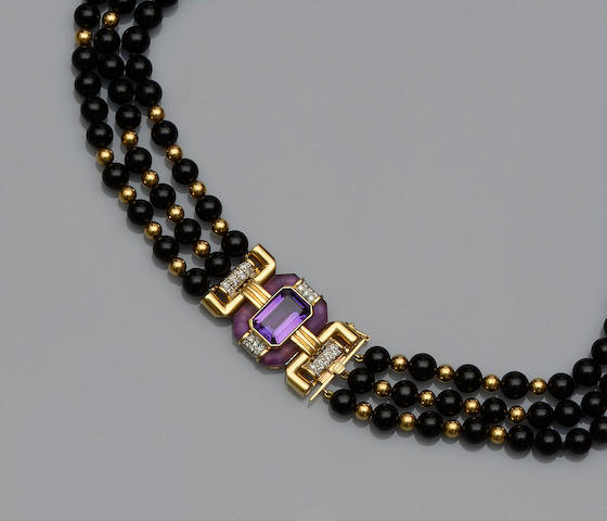 An amethyst, onyx and diamond necklace