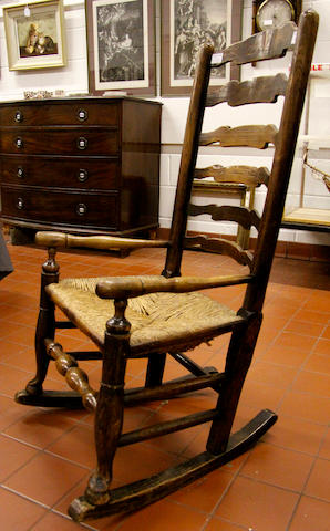 An oak ladderback rocking chair 19th Century