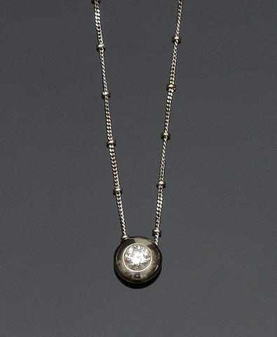 A diamond single stone pendant necklace