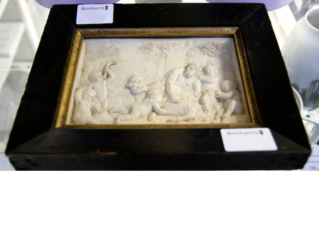 A late 19th century carved plaster plaque.