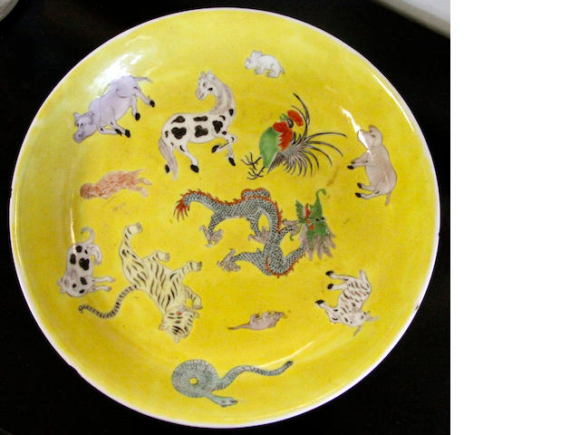 A Chinese yellow ground saucer dish decorated with various animals,