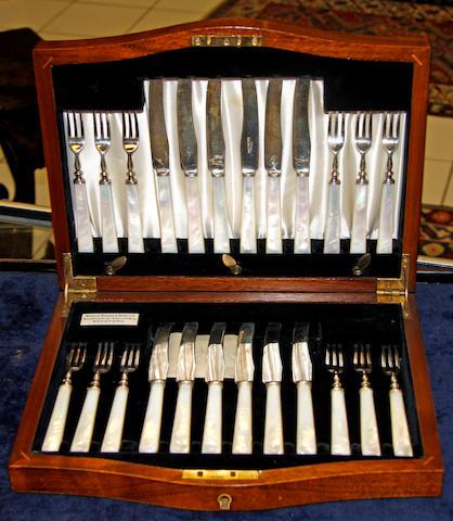 A cased set of twelve fruit knives and forks