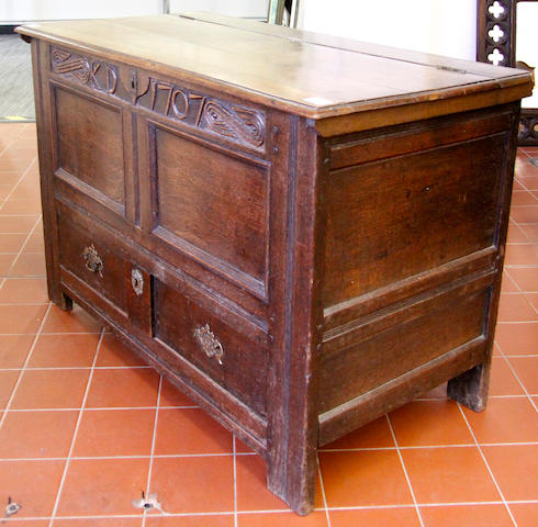 An 18th Century panelled oak mule chest,