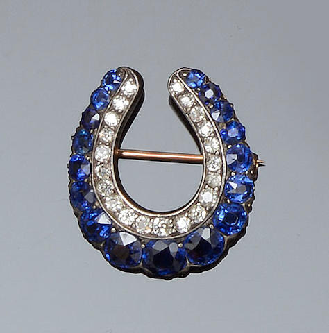 A Victorian sapphire and diamond horseshoe brooch