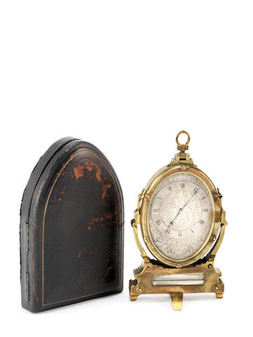A mid 19th century gilt brass strut timepiece in the manner of Thomas Cole Retailed by M.F.Dent