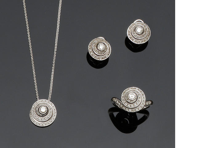 Salvini: A diamond set ring, pendant and earstuds suite (3)
