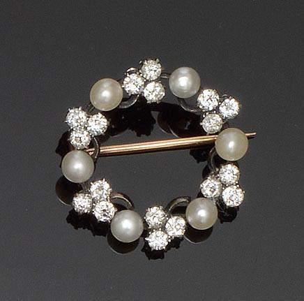 A half pearl and diamond circlet brooch