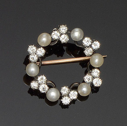A half pearl and diamond circlet brooch
