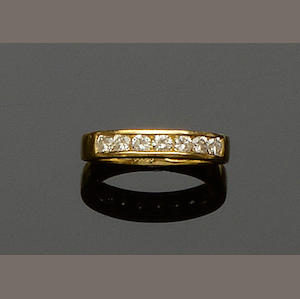 A diamond half hoop ring