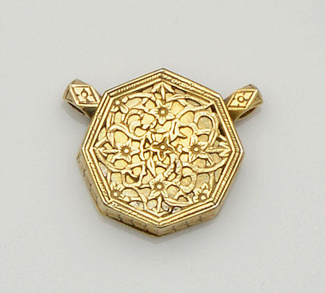 A 17th century Persian silver gilt pendant/amulet
