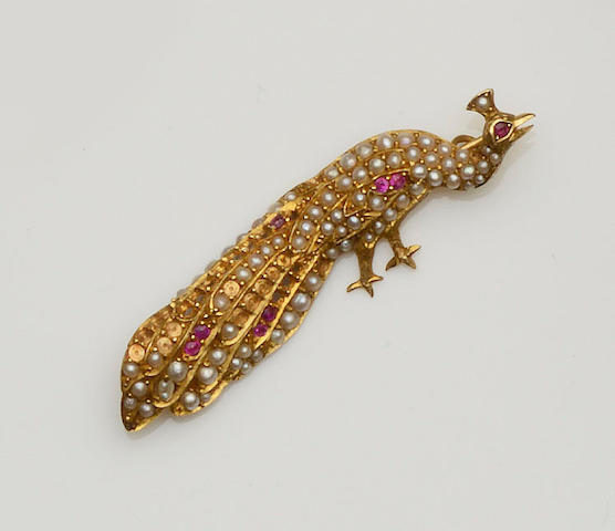 A ruby and seed pearl peacock brooch