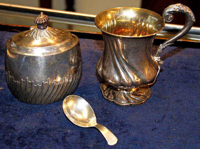 A George III silver caddy spoon,London 1807, a silver Christening tankard London 1874 and a small ovoid tea caddy, Sheffield 1864, weight 11oz.