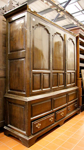 An oak press cupboard,