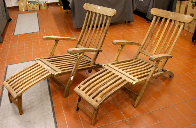 A pair of teak slatted folding garden chairs