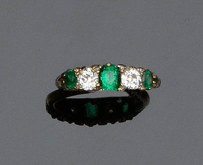 A five stone emerald and diamond ring