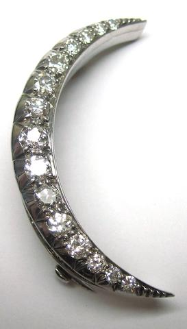 A diamond crescent brooch