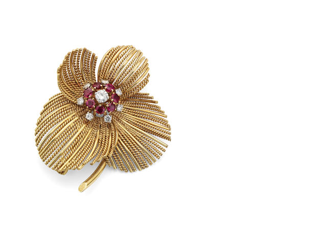 An 18ct gold ruby and diamond brooch, London 1971