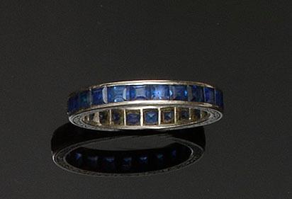 A sapphire full hoop eternity ring