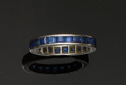 A sapphire full hoop eternity ring