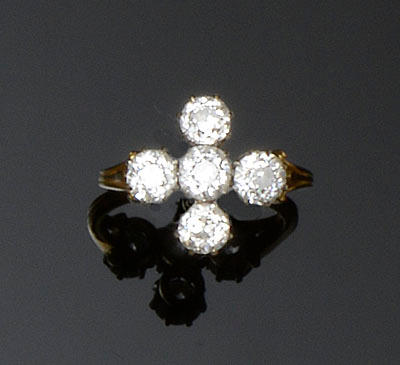 A five stone diamond ring of cross formation