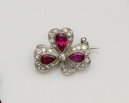 A ruby and diamond trefoil brooch