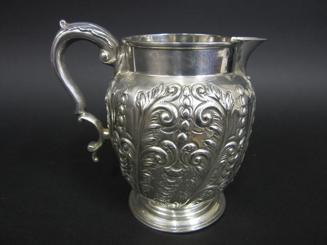 A Victorian silver baluster beer jug by Sibray, Hall & Co., Sheffield 1895