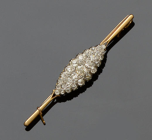 A diamond bar brooch