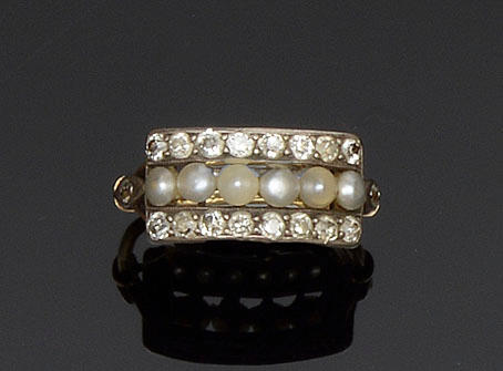 A diamond and half pearl panel ring
