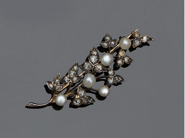 A half pearl and diamond brooch