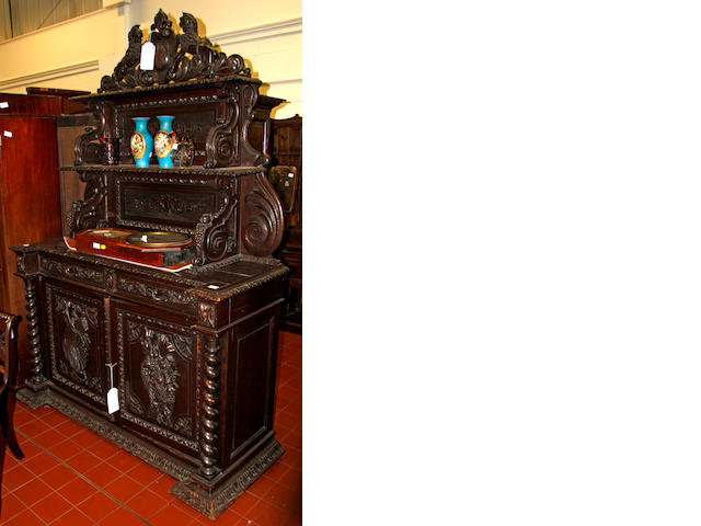 A Victorian carved oak sideboard,