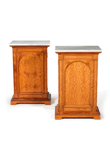 A pair of Victorian satinwood marble topped side cabinetsprobably by Holland & sons