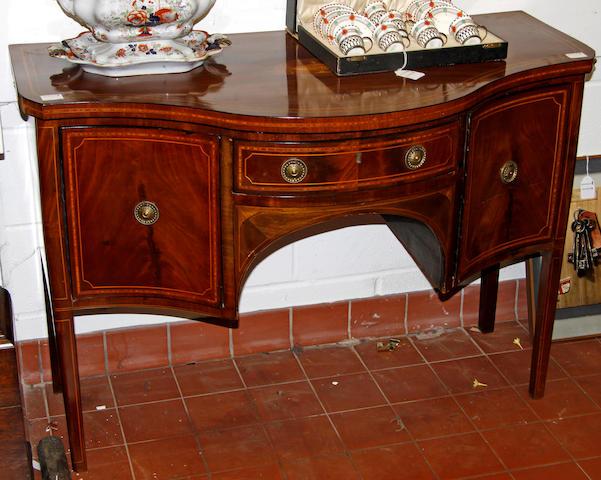 George III mahogany serpentine sideboard