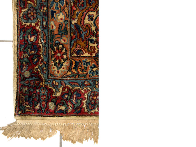 A Kirman carpet,  358 x 454cm